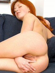 Very horny naked redhead playing